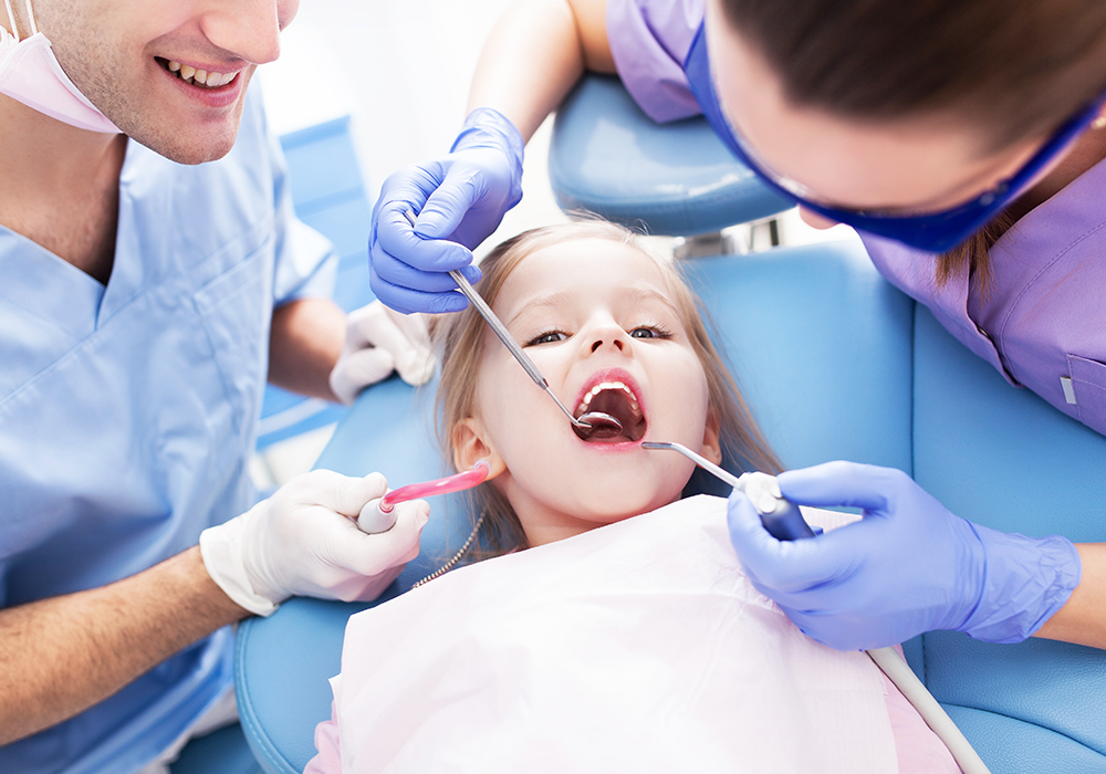 Dentists carrying out children's dentistry