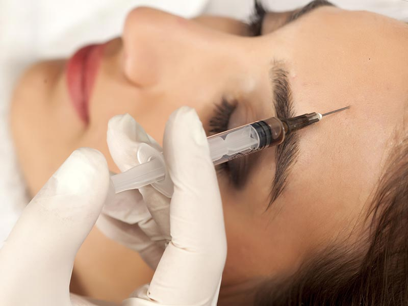 facial aesthetics patient being injected with anti-wrinkle treatment