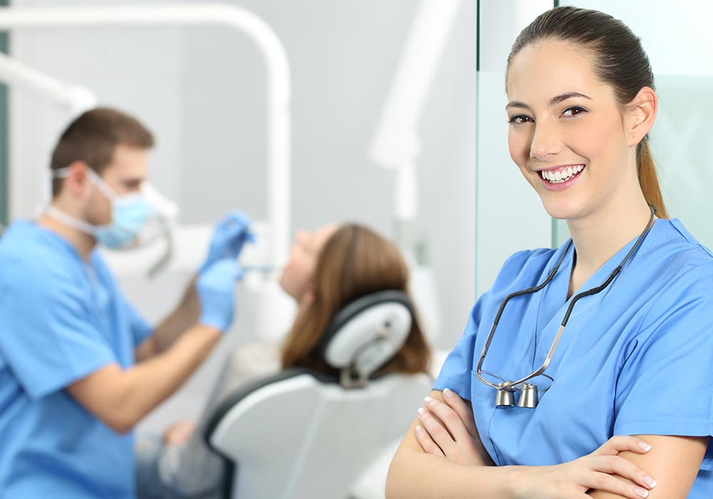 dental professional smiling at camera